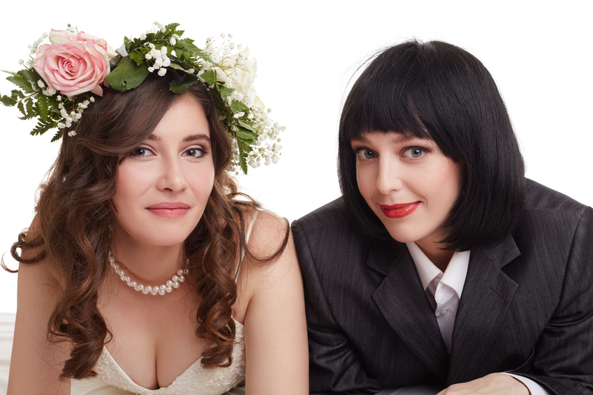 Smiling newlyweds posing at camera. Concept of gay marriage